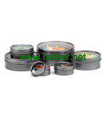 round shallow tin container with clear window for candy pack