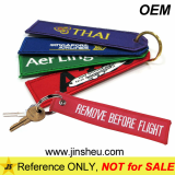 Custom Made Embroidered Remove Before Flight Keychain