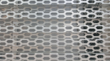 Hexagonal perforated building exterior material