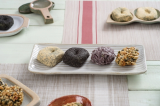 A set of 4 different flavors of omegi rice cake