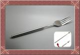 Novelty joke fork with telescopic length