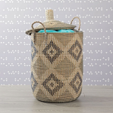 Seagrass laundry basket with cloth inside