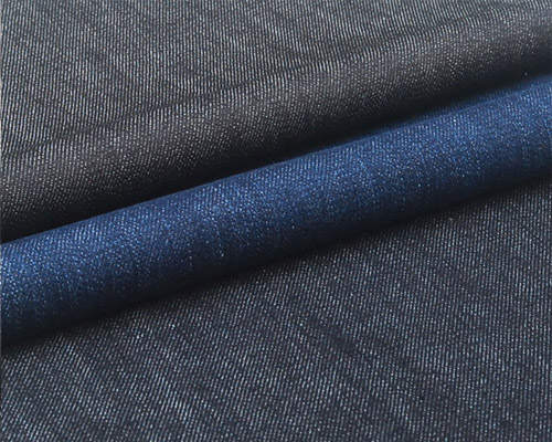 // A mid weight coated denim in dark indigo. The coating on this fabric gives a slight lustrous appearance and great structure. Perfect for jeans, skirts and jackets.